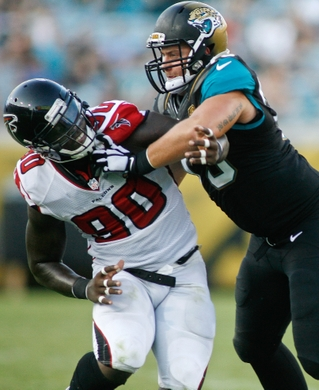 Aug 28, 2014; Jacksonville, FL, USA; Atlanta Falcons defensive end Stansly Maponga (90) is blocked by Jacksonville Jaguars tackle Cody Booth (73) in the second quarter of their game at EverBank Field. Mandatory Credit: Phil Sears-USA TODAY Sports