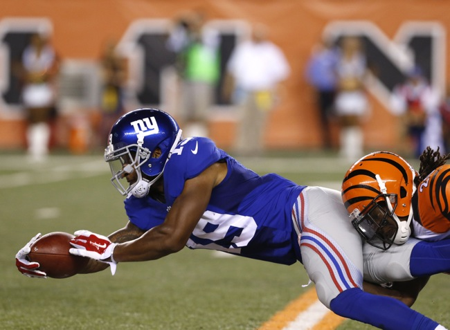 Aug 14, 2015; Cincinnati, OH, USA; New York Giants wide receiver Julian Talley (19) is tackled by Cincinnati Bengals cornerback Josh Shaw (26) in the second half in a preseason NFL football game at Paul Brown Stadium. The Bengals won 23-10. Mandatory Credit: Aaron Doster-USA TODAY Sports